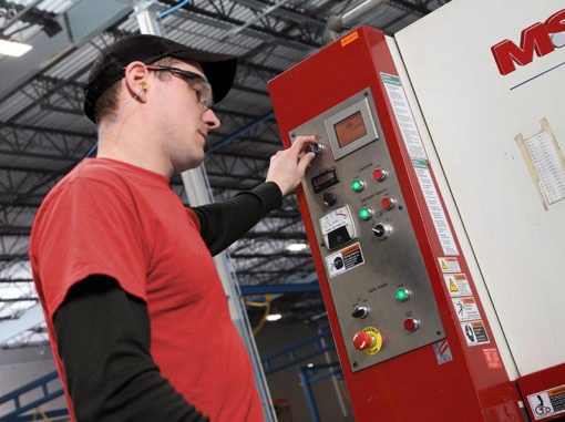 employee using polishing machine