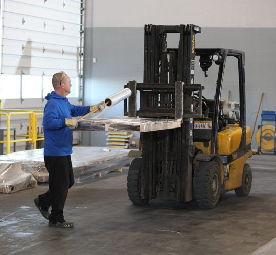 emtek employee with forklift