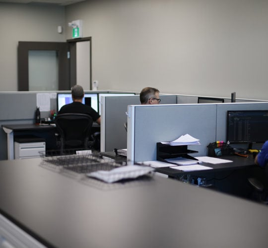 emtek employees working at desks